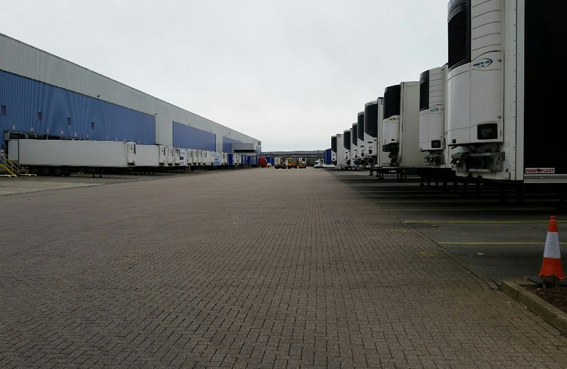 HGV trailers docked for loading. Others await their next duty