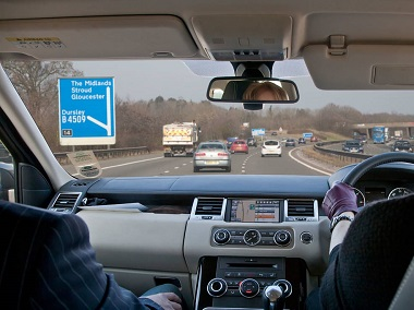 Interior Of Range Rover Car Being Driven By Woman On Motorway In Uk
