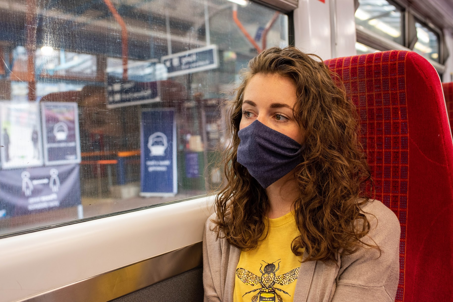 Woman in mask on SWR train