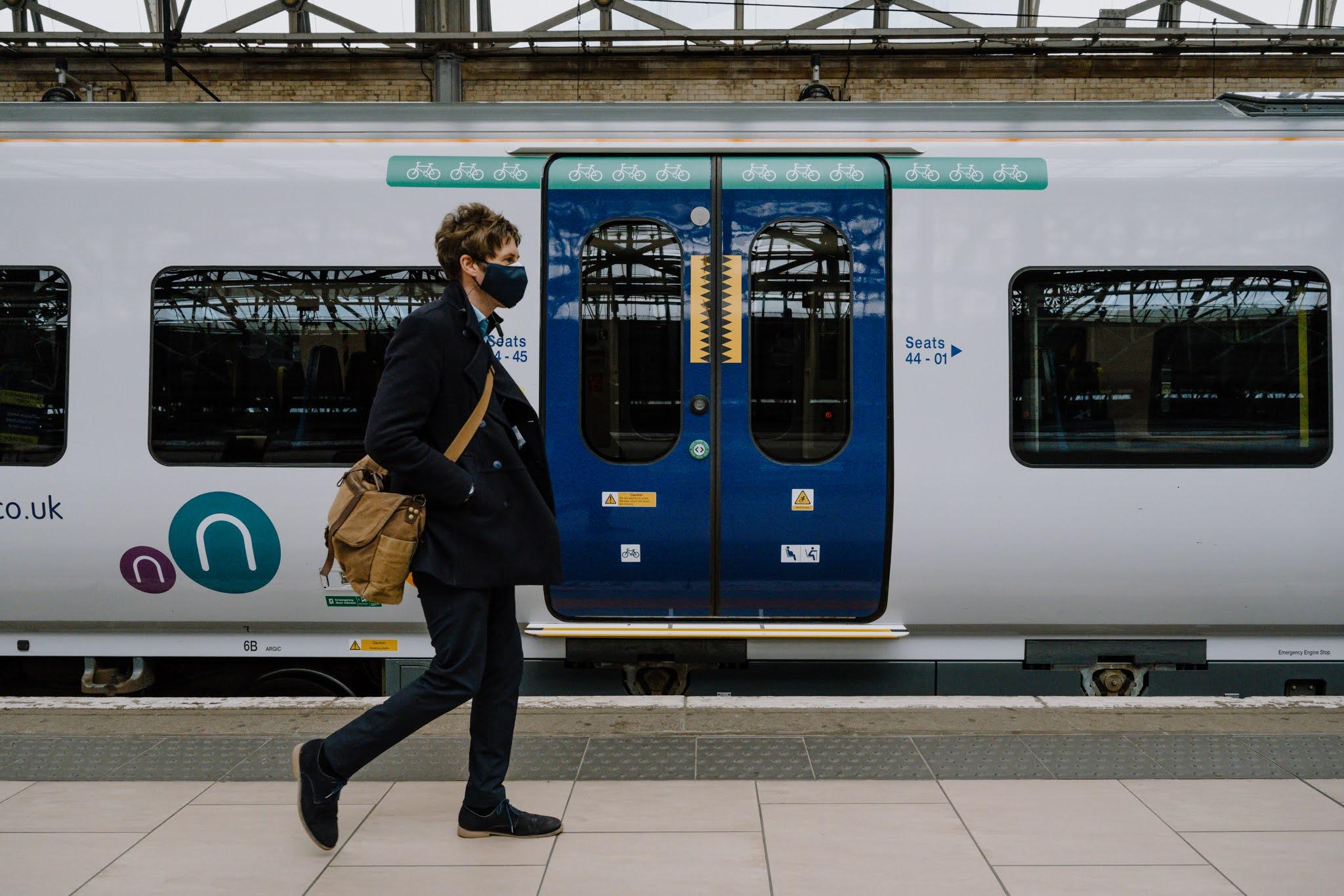 Passenger walking along station platform
